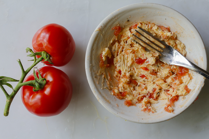 Creamy, vibrant tomato butter, add some thinly sliced basil later