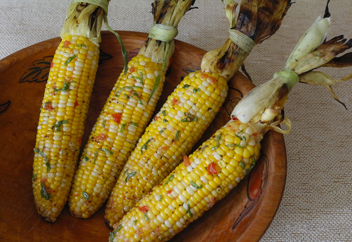 """Ready to serve in a nice vintage wooden bowl - tie corn husks back with a reserved """"husk-tie"""""""