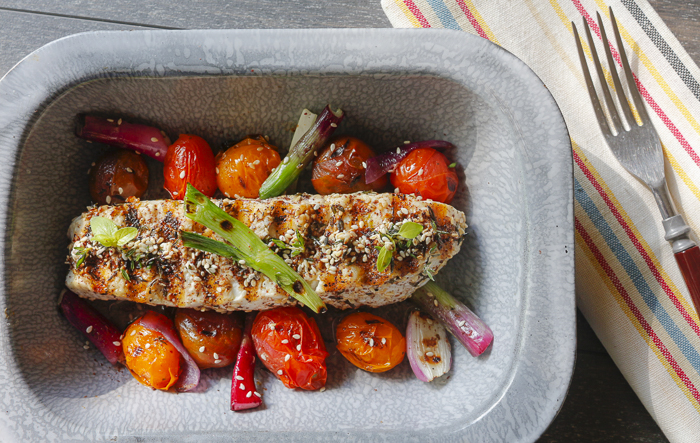 Spread Za'atar over freshly cut Halibut - grill with colorful Cherry Tomatoes and Onions