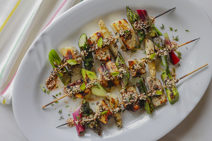 Spread Za'atar seasoning over luscious grilled skewers of Halloumi Cheese, Fresh Spring Asparagus and Scallions