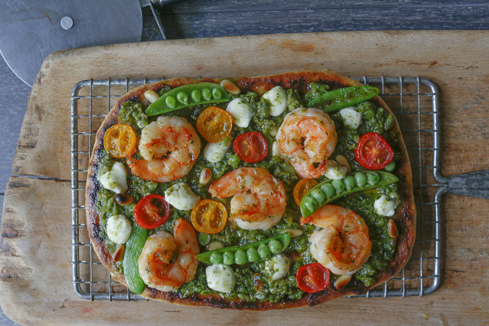 This special pesto is used as a base on Naan Bread (or Pizza) -top with some Shrimp, Goat Cheese, Tomatoes and some Sugar Snap Peas