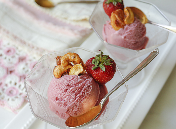 Top the ice cream with an easy Cashew - Brittle and a just- picked Strawberry