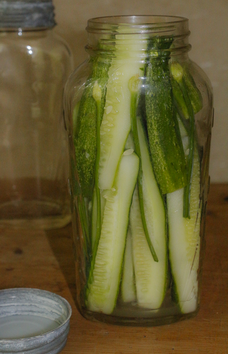 Pack in the cucumbers, then add your hot brining solution