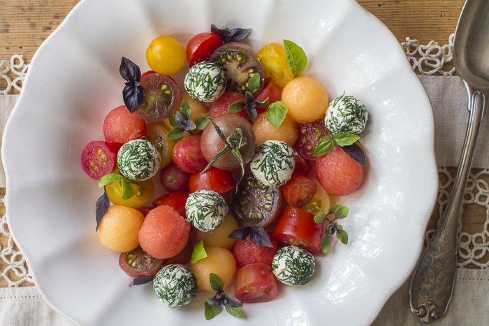 Heirloom Cherry Tomatoes, Summer Cantaloupe and Watermelon Balls, Goat Cheese Balls covered in Dill and Basil Sprigs complete the Salad