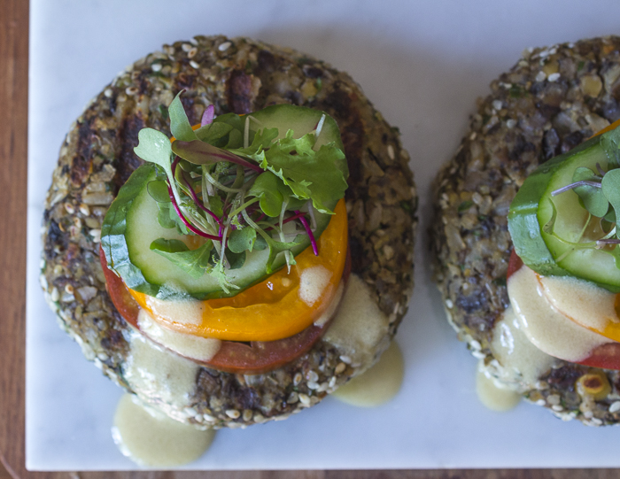 "These burgers are great served ""open-faced"" with stacks of veggies and some microgreens"