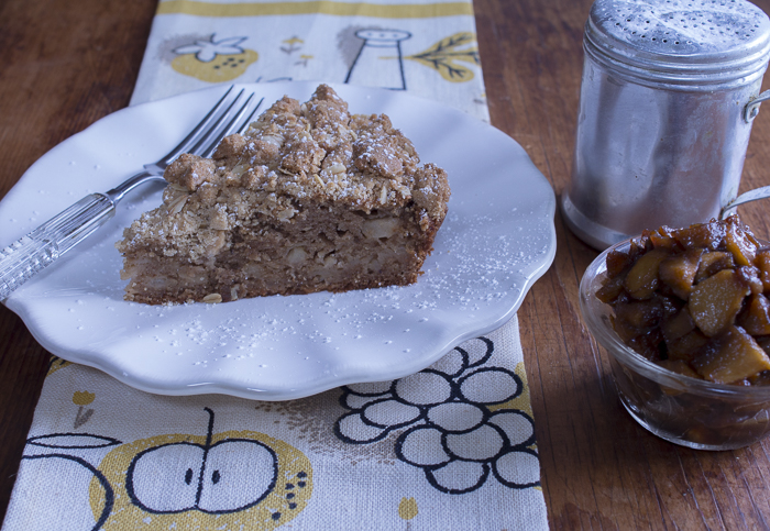 A slice of Apple Cake with the Caramelized Apples served on the side