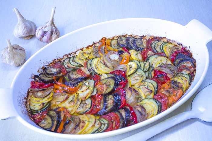 The roasted Tian with thinly cut layered vegetables, sliced garlic, extra virgin olive oil and rosemary