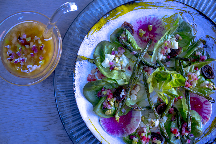 Serve the salad on individual plates with some extra Vinaigrette on the side