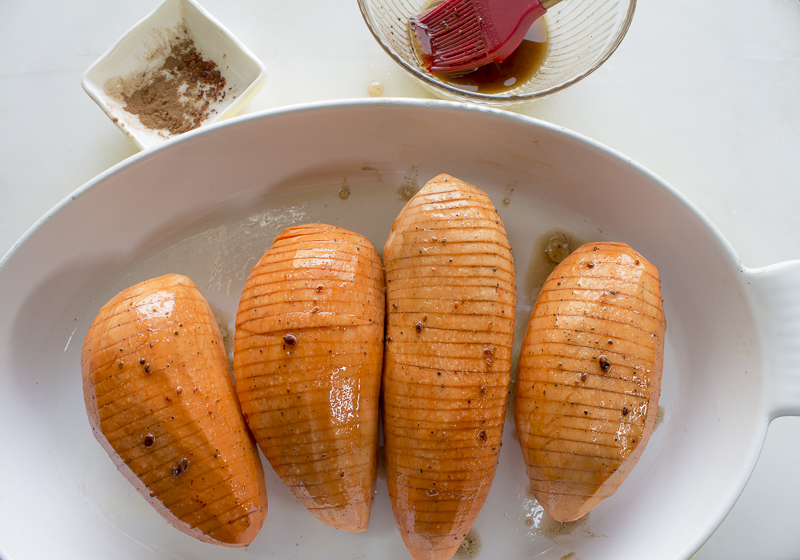 Place potatoes in a baking dish and bake, covered until softened