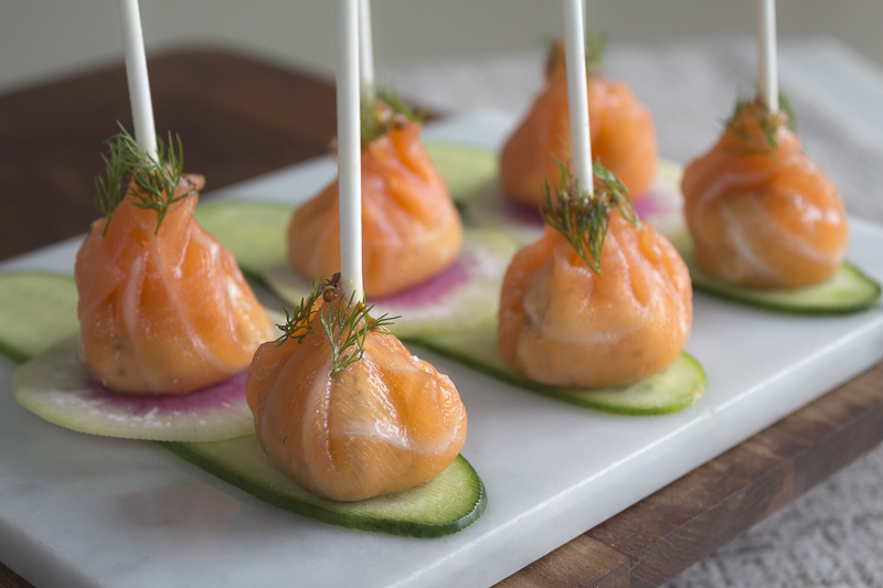 The perfect holiday appetizer - smoked salmon wrapped around a flavored cream cheese
