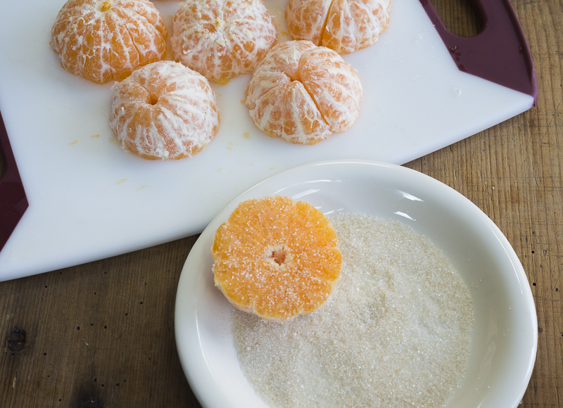 Coat the cut sides of clementines with a little pure cane sugar, then caramelize in a skillet