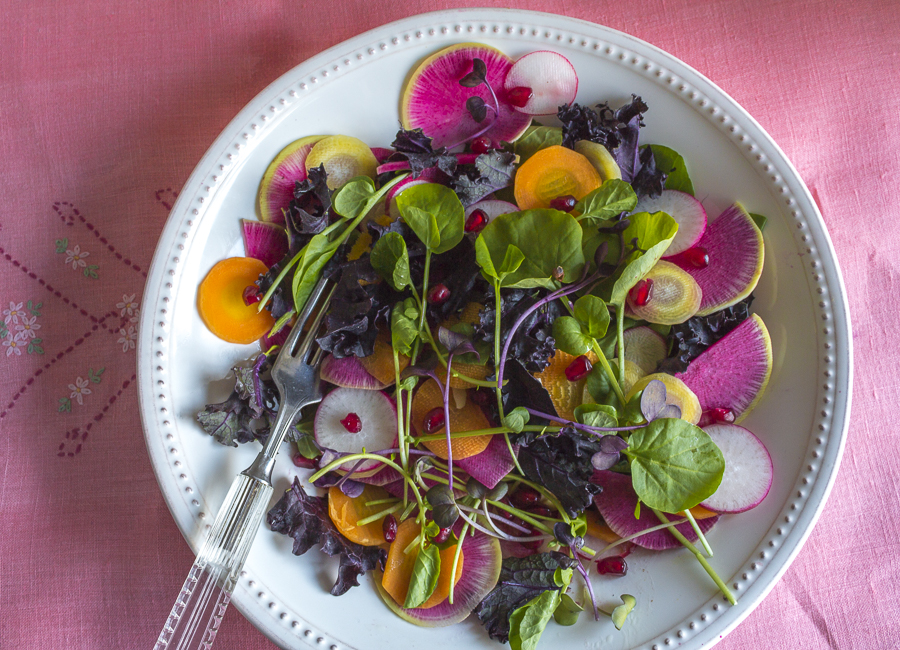 A beautiful mix of Greens, Watermelon Radish, Carrots, Microgreens and Pomegranate Seeds