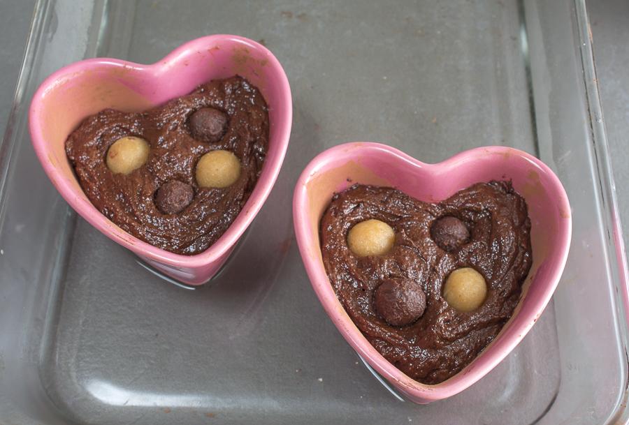 Fill the ramekins three-forths full, drop in truffles and bake.
