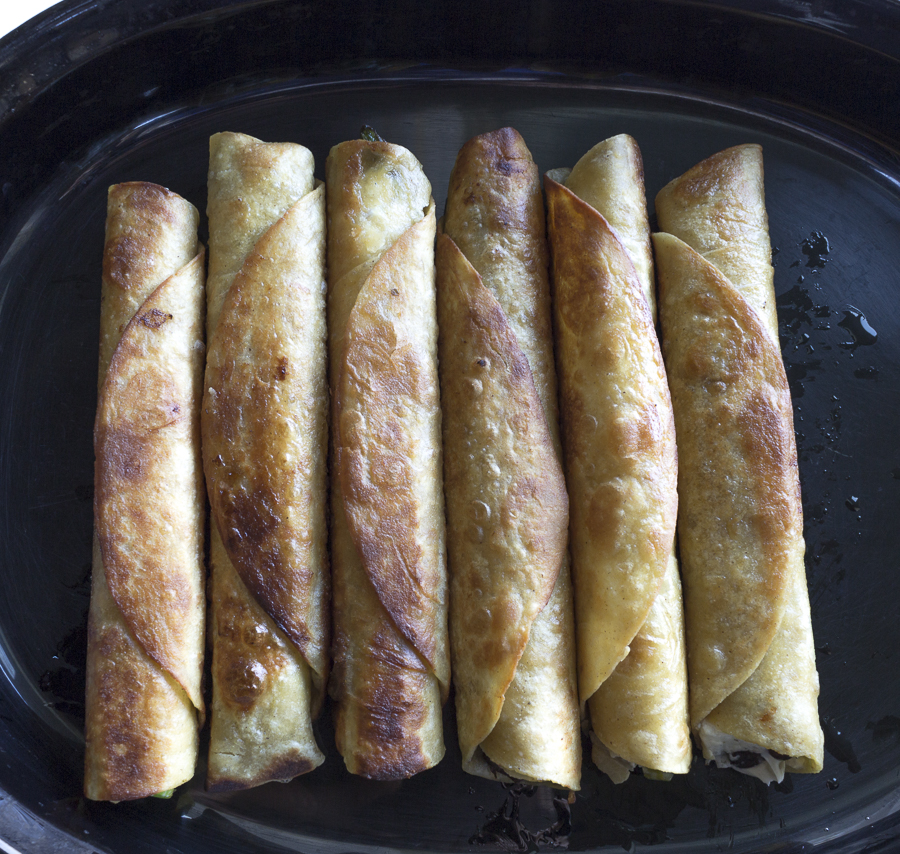 Cook the Taquitos, seam side down in a little oil, then bake for a lighter taste