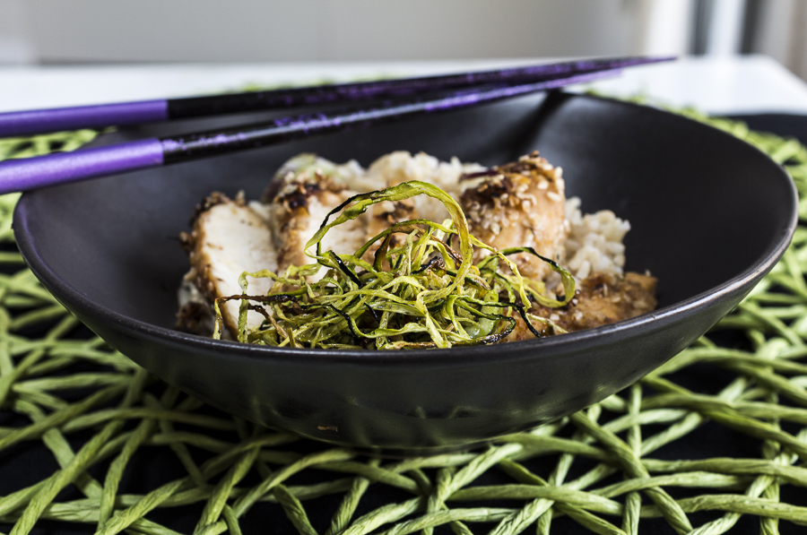 Slice the sesame coated chicken and serve with roasted zucchini over steamed brown rice