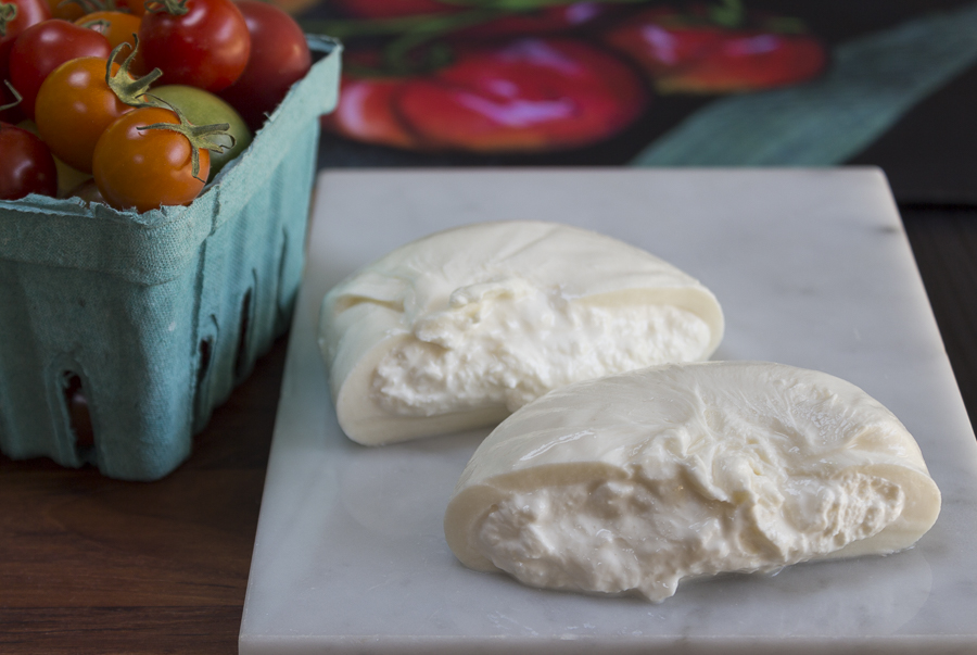 The wonderful interior of Burrata - mozzarella style on the outside, creamy ricotta texture on the inside