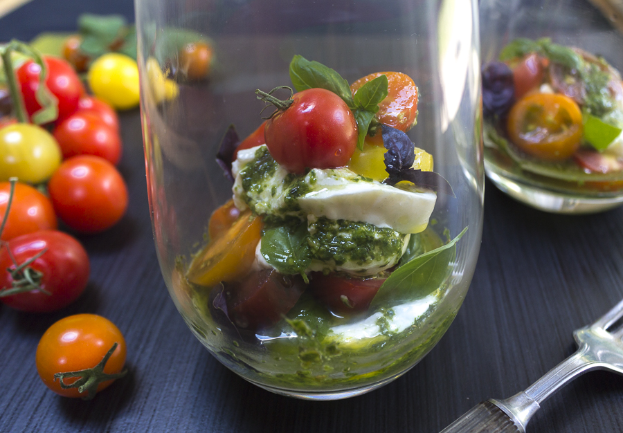 Layer creamy Burrata with ripe, colorful cherry tomatoes, basil leaves and drizzle with Pesto Vinaigrette