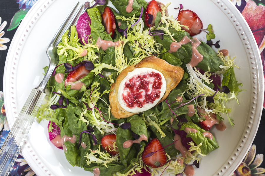 Triple Strawberry Delight! Salad with strawberry vinaigrette, goat cheese crouton with a strawberry jam swirl an sliced strawberries throughout the salad