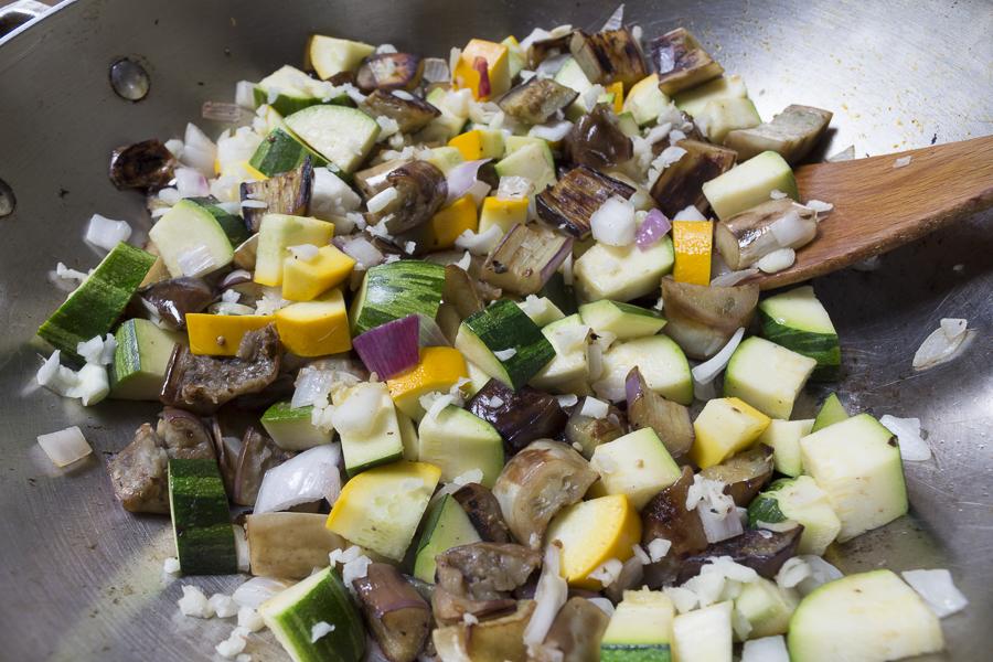 Sauté the eggplant, then add the vegetables
