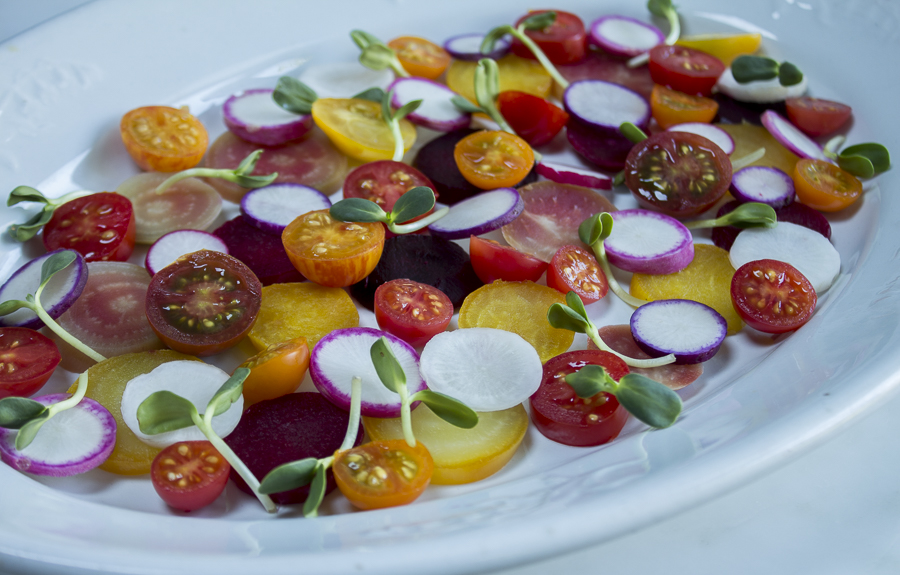 Multi colored beets,  tomatoes and radishes together make for a delightful summer salad ~ sunflower sprouts add crunch and color