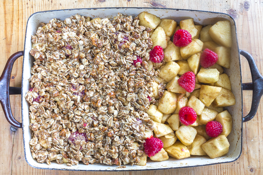 Simply add apples and raspberries to the pan,  cover with the topping and bake