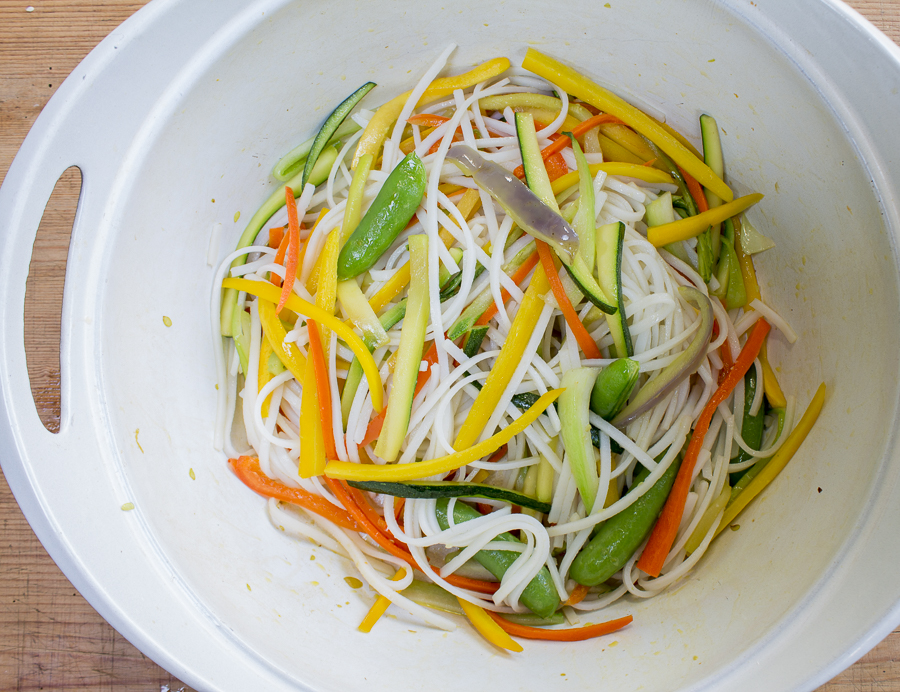 Sauteed vegetables combined with soaked rice noodles - then add the simmering sauce
