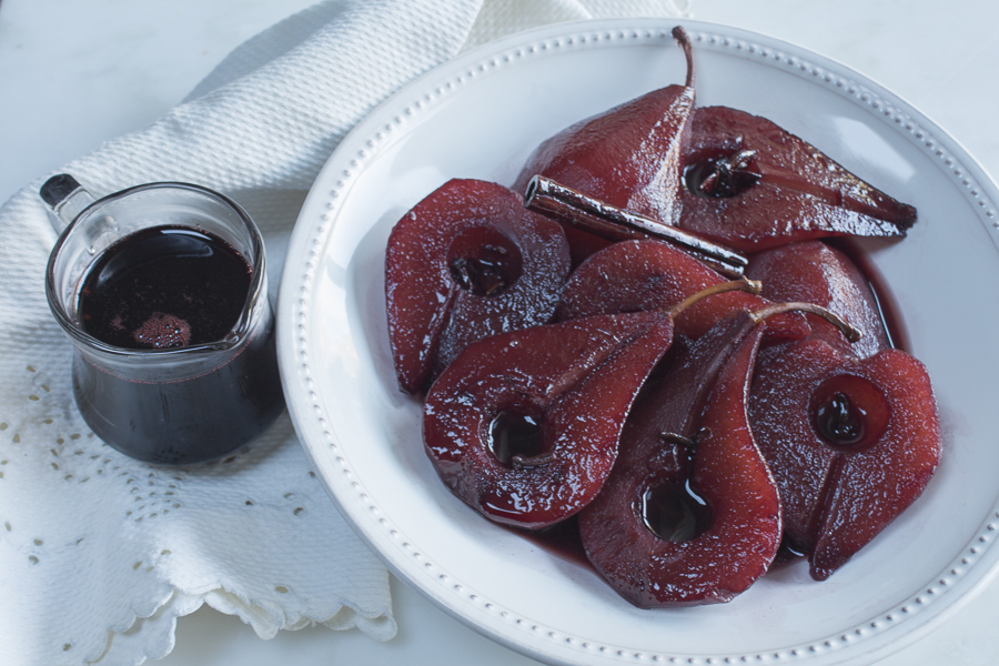 The finished poached pears - drinking up the colorful flavors, with reduced syrup