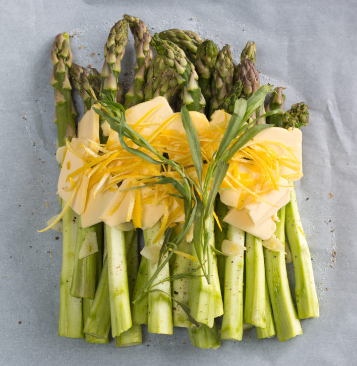 Spring Asparagus Cooked in Parchment Over Pasta
