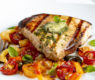 Pesto Compound Butter over Grilled Swordfish with Slow-Roasted Heirloom Tomatoes & Peppers